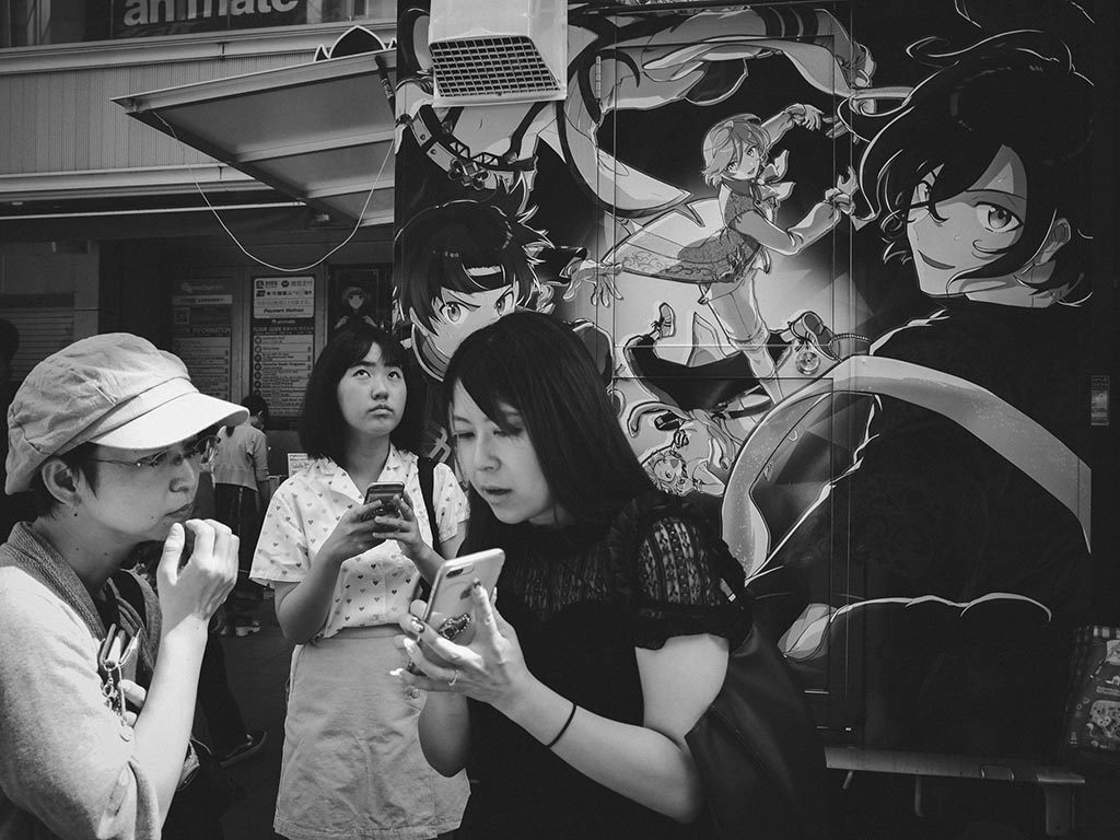 William Sudhana Tokyo Street Photography Women thinking and asking for Direction
